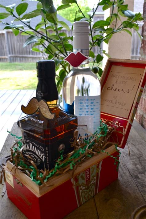 cute housewarming gifts cute housewarming gift a bottle of what he drinks and a