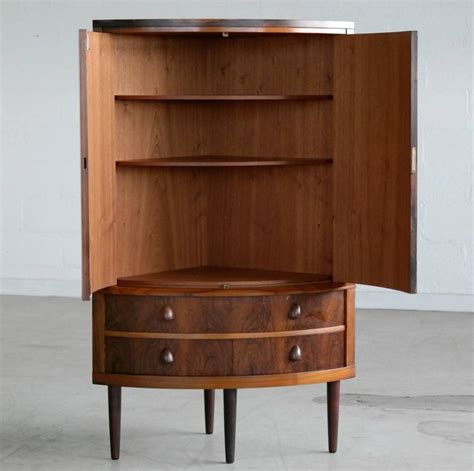 mid century corner cabinet attributed to frode holm in
