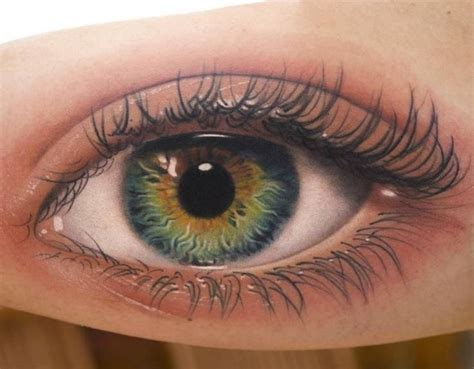 eye tattoo green read complete realistic eye tattoo on bicep by amayra