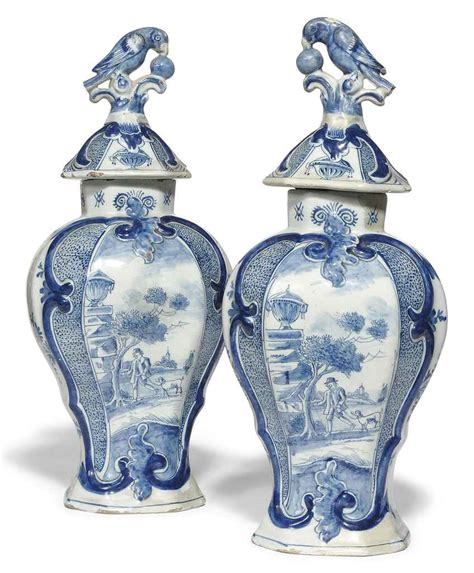 Delft Vases by A Pair Of Delft Vases And Covers 19th Century