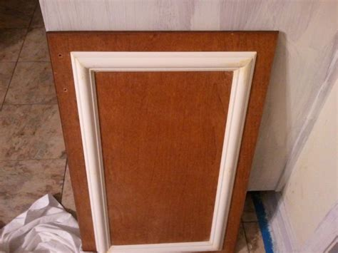 how to fix cabinet door panel add trim and a coat of paint to cabinets for a