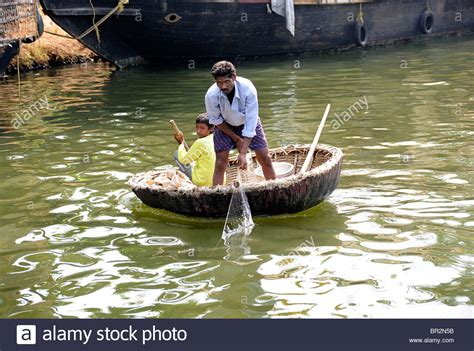 father and son fishing from a circular boat the - Circular Boat