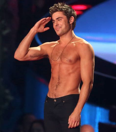 zac efron got shirt ripped off at the mtv movie awards