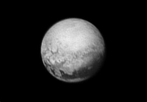 nasa pluto images pluto nasa photos reveal new features on planet s surface