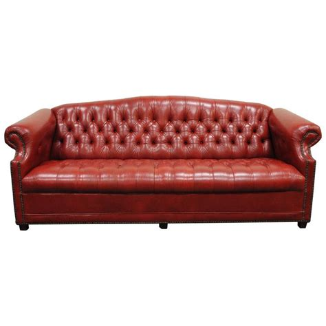 red velvet tufted sofa red tufted sofa clic scroll arm tufted velvet chesterfield