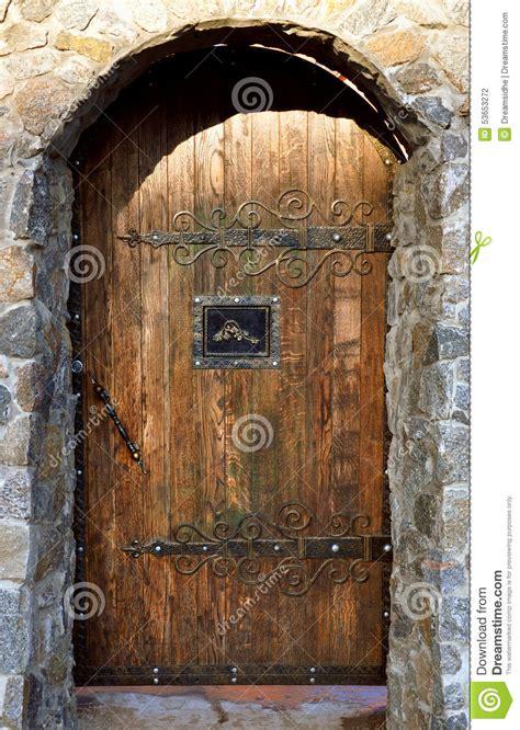 brick arch  wooden doors stock photo image  house