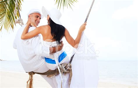 couples swinging photos beautiful couple swinging on the beach stock photos