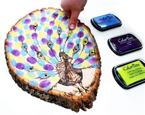 enfold theme guestbook peacock fingerprint design wood slice rustic theme