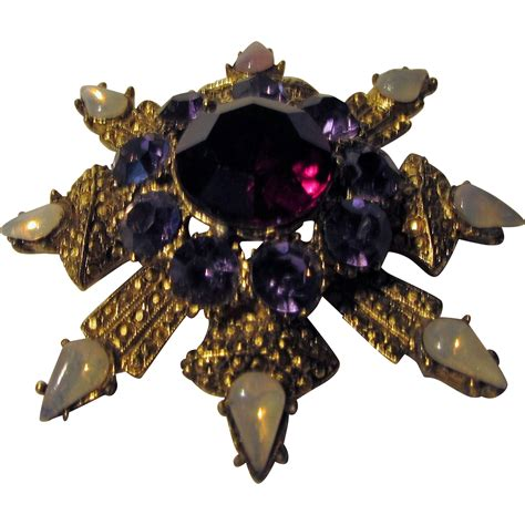 unusual colors vintage pin in unusual colors snowflake shape from