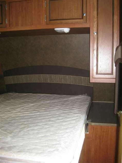 overhead bed bed with overhead storage in this jayco rv travel