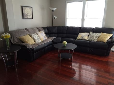 yellow sectional couch black sectional couch with yellow throw pillows and cherry