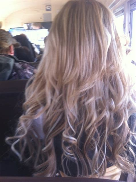 middle of back length weave above shoulder length heavily highlighted blonde hair to