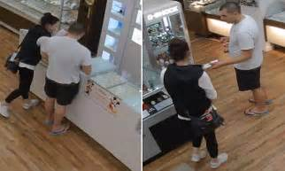 CCTV of thieves stealing a bracelet from a jewellery store   Daily Mail Online