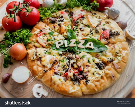 large pizza table large pizza on a wooden table restaurant stock photo
