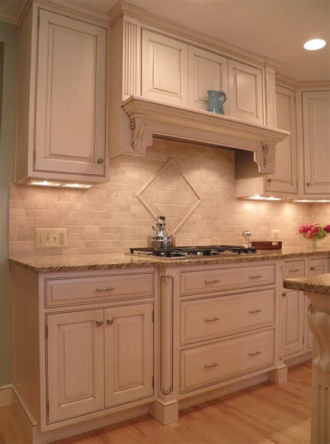 American Woodmark Kitchen Cabinets tumbled marble backsplash kitchen contemporary with corbel