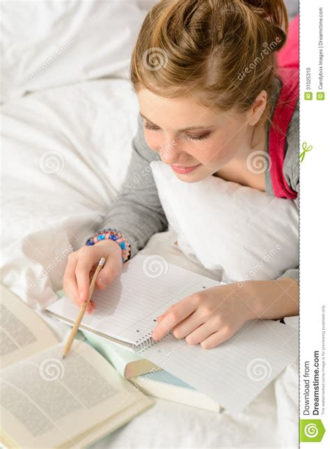 studying in bed teenage girl concentrating on studying in bed stock photo image 31025310