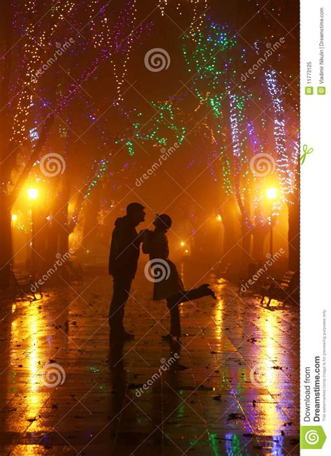 light for walking at night couple walking at alley in night lights stock photography