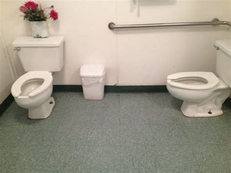 ladies using the bathroom women s bathroom two toilets but no stall walls good for using the restroom with