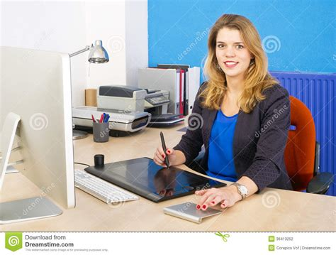graphic design works at home smiling woman at work stock photography image 36413252