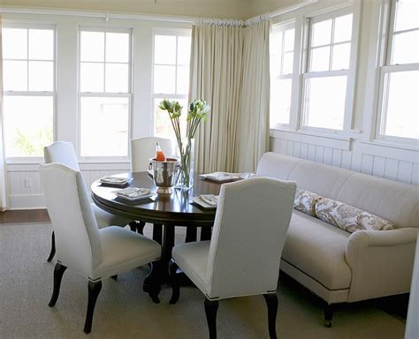 dining room table with sofa seating soften up your dining room with a sofa 3