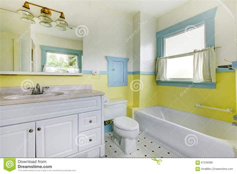 bathrooms with yellow walls bathroom with yellow walls white tile floor and full bath stock photo image 67239386