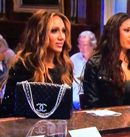 melissa gorga part black melissa gorga s black beaded sleeve blouse big blonde hair