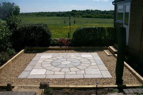 Patio Area garden landscaping project in bredbury indian stone and