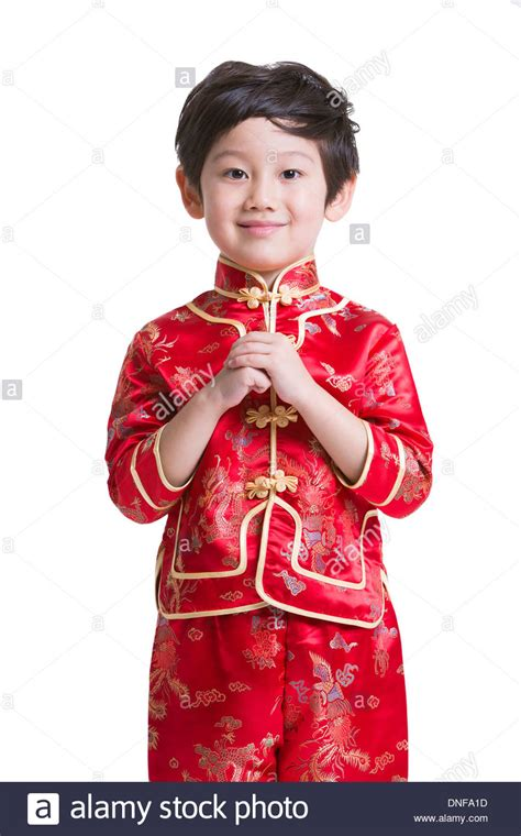 new year traditional dress boy in traditional clothing greeting for new