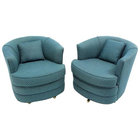 swivel barrel chairs pair of swivel barrel lounge chairs at 1stdibs