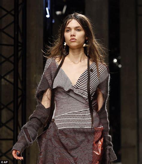 runway model wardrobe malfunction vivienne westwood rescues paris catwalk model who suffers
