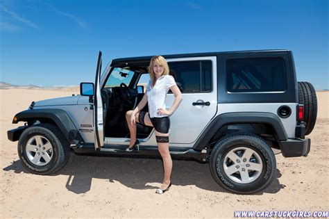 jeep jk girls blonde in stockings with a silver jeep wrangler 4 door