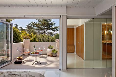 Nana Doors by Nana Doors Entry Midcentury With Balcony Container Plants