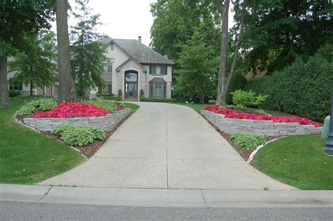 concrete driveway ideas Landscape Traditional with brick driveway concrete driveway