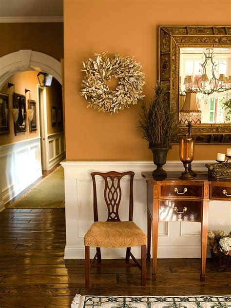 foyer decorating ideas swish wreath hang on orange wall painted and carving