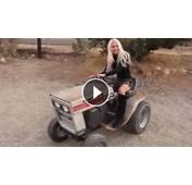 Woman In A Mans World Blonde Girl Driving Old Garden Tractor