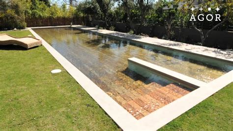 Outdoor Patio Floor Covering by This Insane Disappearing Pool Cover Doubles As A Deck