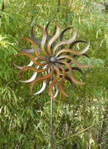 windrad art ferro sonne gartenstecker metall windspiel
