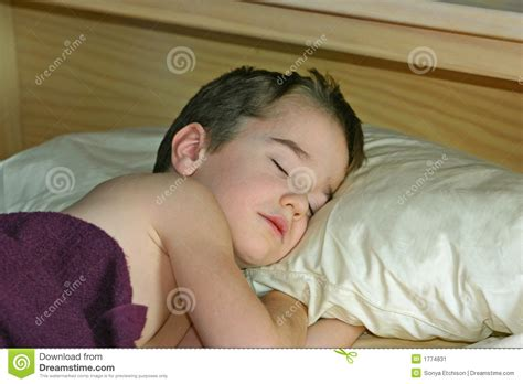 boys in bed boy sleeping in bed stock image image of child down 1774831