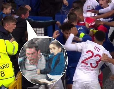 Armchair In French Everton Fan Carrying A Child Slaps Lyon Goalkeeper Daily