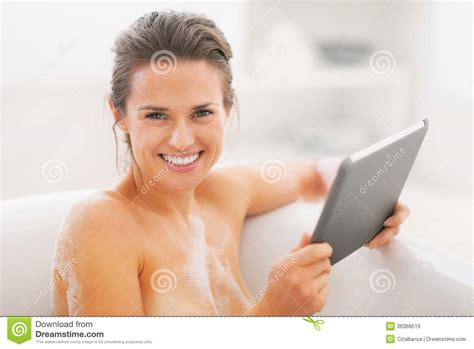 happy young woman  tablet pc  bathtub royalty  stock images image