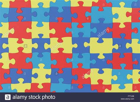 autism awareness colors puzzle pieces in autism awareness colors background 3d