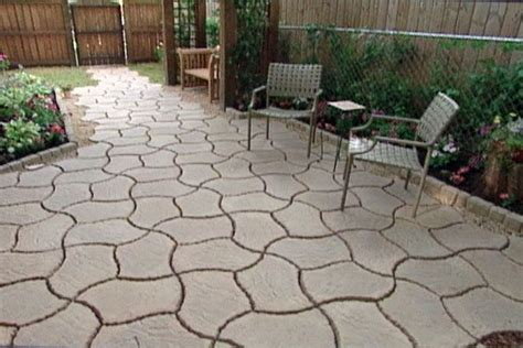 use interlocking concrete patio pavers to turn a plain back yard into a charming cottage patio Interlocking Patio Pavers