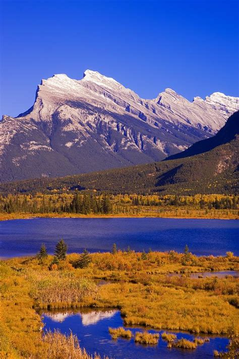 Mrc Carson Blue Sky vermilion lakes and mount rundle in photograph by carson ganci