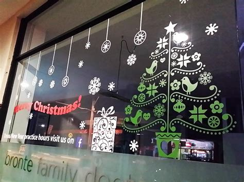 window decals make this christmas a success signs