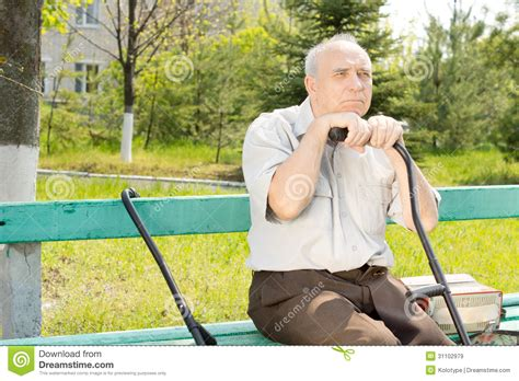 sitting on the bench waiting for you sitting on the bench waiting for you old man outdoors