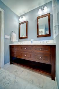 Custom cabinets blue bathroom double vanity with mirrored cabinets