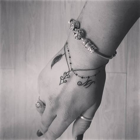 wrist charm bracelet tattoo bracelets are a thing and we want them all forget