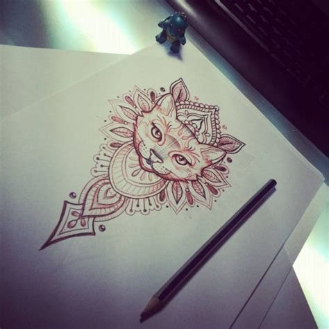 attractive cat muzzle on indian pattern background tattoo