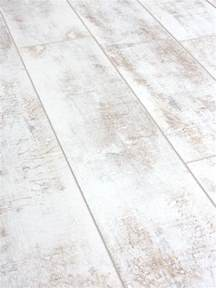 sample of distressed white laminate flooring 12mm ac4