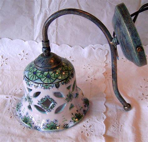 applique in ceramica applique lume canella in ceramica con braccio in